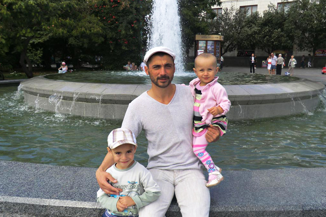 Family archive picture: Reshat Ametov,39 seen with 2 of his children, Alij,5 and Khatidzhe, 2,5.